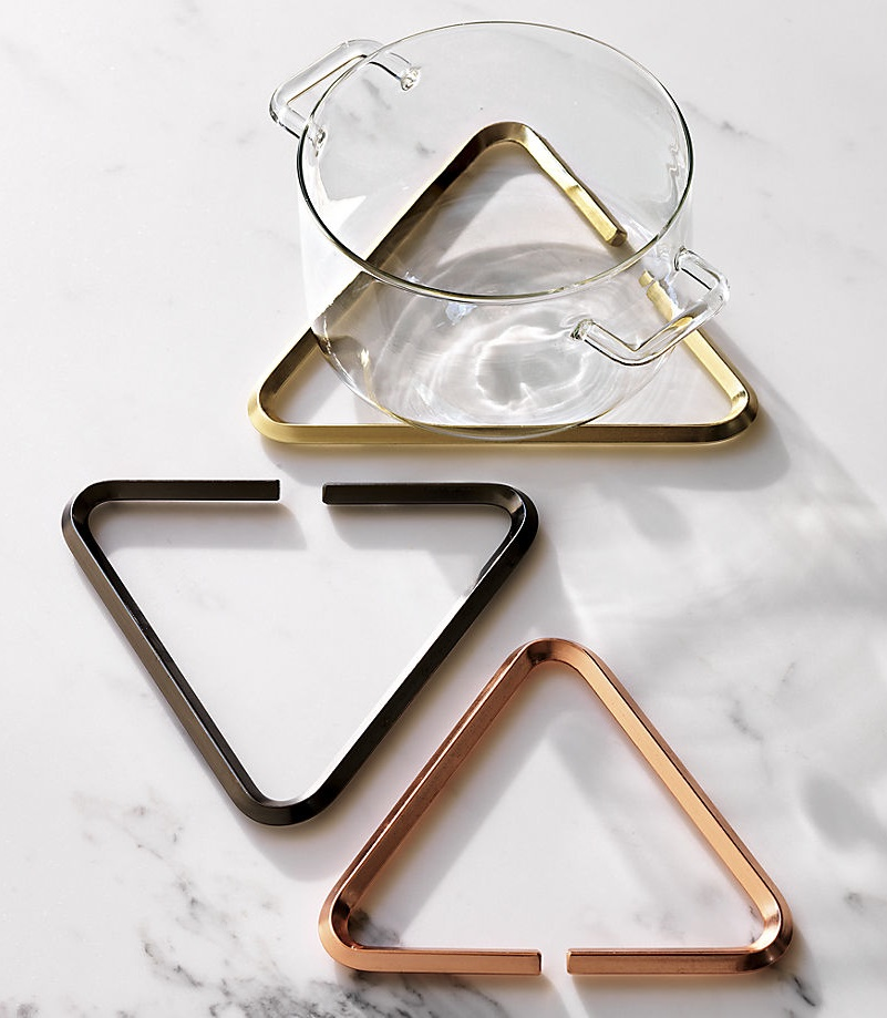 Metal coaster-in-black-rose gold-and-messing-tones-from-CB2